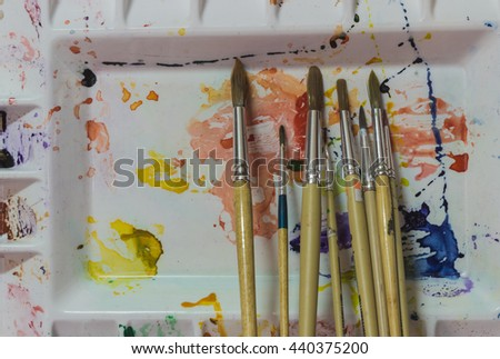 Palette and paint brush , drawing tools . - stock photo