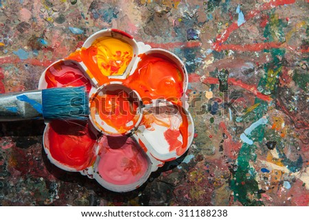 Palette color on the surface soiled with paint.  - stock photo