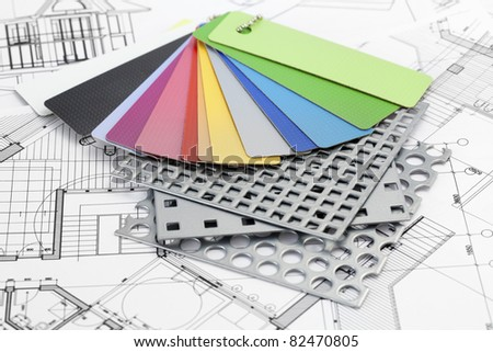 palette of color samples of plastics, PVC, for furnishing, perforated metal, coated with a polymer and architectural plans for houses - stock photo