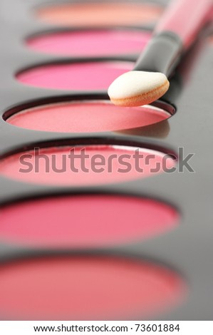 Palette of colorful blushes and applicator close-up. - stock photo