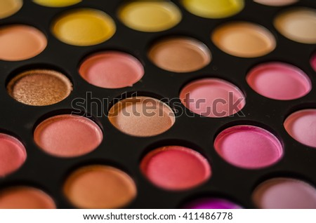 Palette of colorful eye shadows. - stock photo