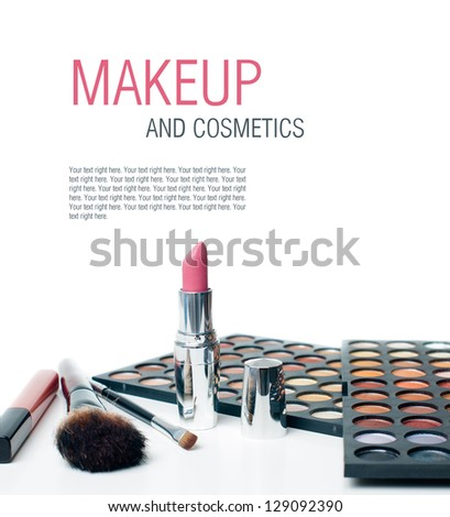 Palette of colorful eyeshadows, lipstick and makeup brushes, close-up, isolated - stock photo