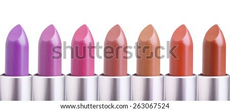 palette of colorful lipsticks in line assortment isolated on white background