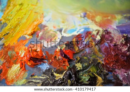 Palette with colorful oil paints, background, texture,