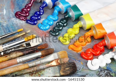 Palette with oil paint and brushes - stock photo