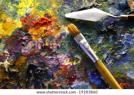 palette with paintbrush and palette-knife - stock photo