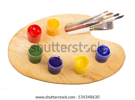 Palette with paints and brushes of the artist on the white - stock photo