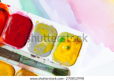 Palette with water color paints and brush for drawing - stock photo
