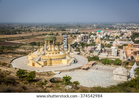 Palitana, India - January 20th 2016 - One of the many temples in the Palitana's complex in west India. Golden color details, blue sky. Palitana, India