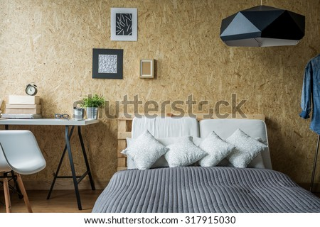 Pallet bed frame in contemporary minimalist interior - stock photo
