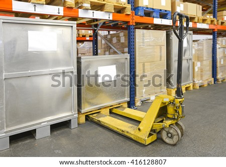 Pallet Jack Truck in Distribution Warehouse