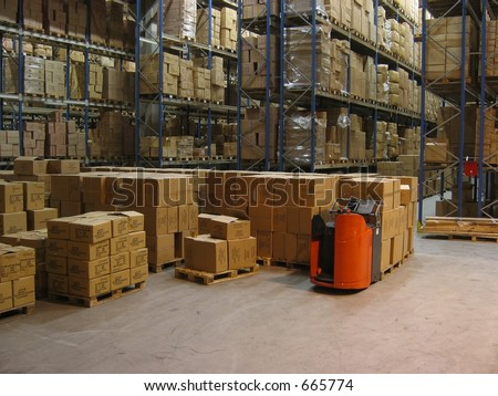 Pallets and shelves in a warehouse - stock photo