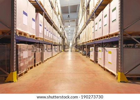 Pallets with printing paper in distrbution warehouse - stock photo