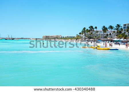 Palm Beach at Aruba island in the Caribbean Sea - stock photo