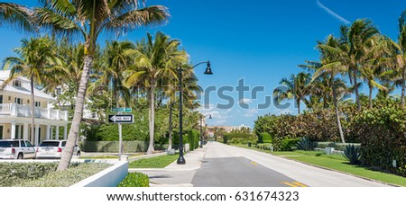 PALM BEACH, FL - JAUNARY 8, 2016: City streets on a beautiful day. Palm Beach is a major Florida destination for tourists.