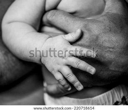 Palm grandfather and grandchild - stock photo