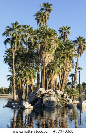 Palm Island of rocks and bouldrs in the middle of Encanto park lake, Phoenix downtown, Arizona