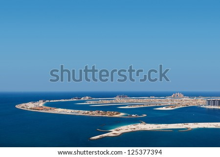 Palm Jumeirah, Dubai is a hugely popular residential area. The Palm Jumeirah is an artificial archipelago created using land reclamation by Nakheel, a company SQUARE owned by the Dubai government. - stock photo
