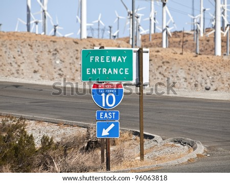 Palm Springs California mojave desert interstate freeway sign with windmills. - stock photo