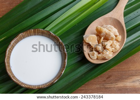 palm sugar, natural food ingredient. good for health with coconut milk cream - stock photo