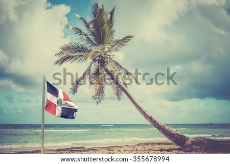 Palm tree over caribbean sea in Dominican Republic - stock photo