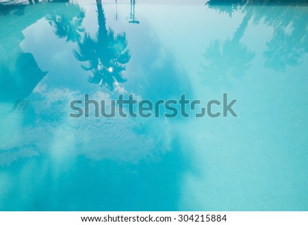 Palm Tree Reflection in the swimming pool - stock photo