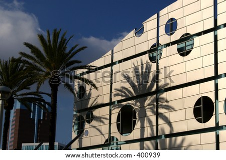 Palm tree shadows are cast upon a wave-shaped parking garage in Long Beach, California.