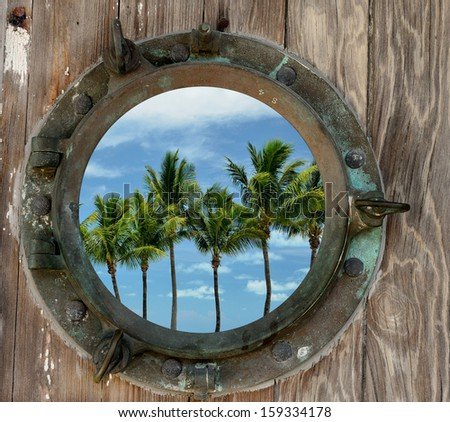 Palm Trees Against Blue Sky With White Clouds Seen Through A Rustic Old Porthole - stock photo
