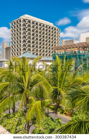 Palm trees and building tops in Honolulu, Hawaii, USA. Tropical city vacation background. - stock photo