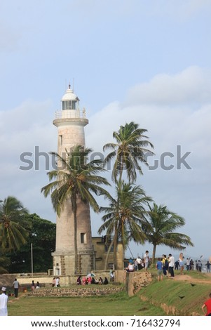 Palm trees and lighthouse in unesco world heritage city Galle, Sri Lanka.