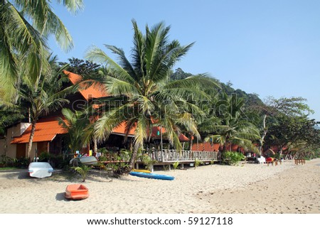 Palm trees on the sand beach in Koh Chang island in Thailand