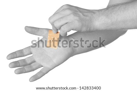 Palm with Healing plaster. Isolated on white.