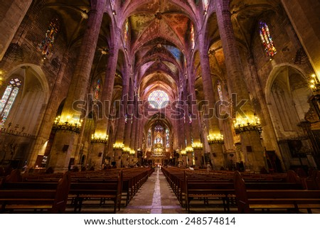 Palma de Mallorca, Spain, July 18 2014: Believers and tourists visit the church of La Seu, is one of the most popular places in the city - stock photo
