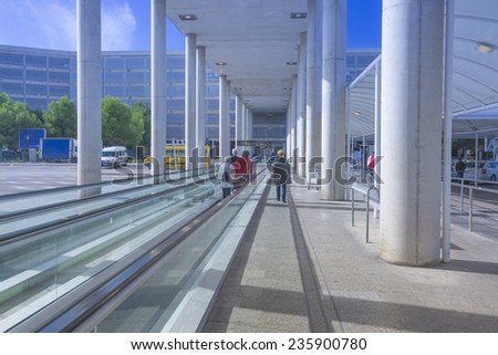 PALMA DE MALLORCA, SPAIN - NOVEMBER 4 2013:  Travelator towards buses and parking garage, welcoming sunny weather and blue sky on November 4, 2013 in Son Sant Joan, Palma de Mallorca, Spain. - stock photo
