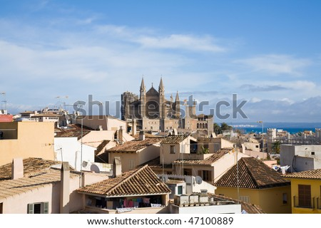 Palma de Mallorca; view over the rooftops; from the old city walls towars the cathedral La Seu; horizontal format - stock photo