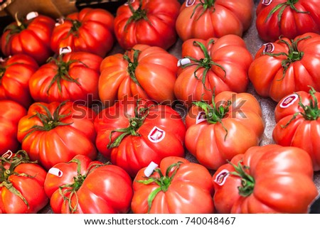 PALMA, MAJORCA, SPAIN - OCTOBER 18, 2017: Close-up of large pink Monterosa tomatoes for sale