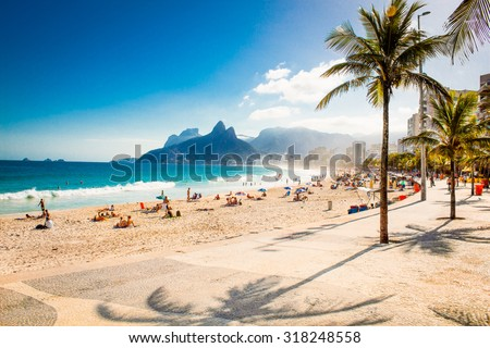 Palms and Two Brothers Mountain on Ipanema beach in Rio de Janeiro. Brazil. - stock photo
