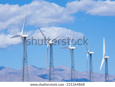 PALMS SPRINGS , CALIFORNIA - NOV 02 : Group of windmills for renewable electric energy production in Palms Springs , California on November 02 2014