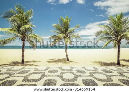 Palms with mosaic on Empty Ipanema Beach in Rio de Janeiro, Brazil - stock photo