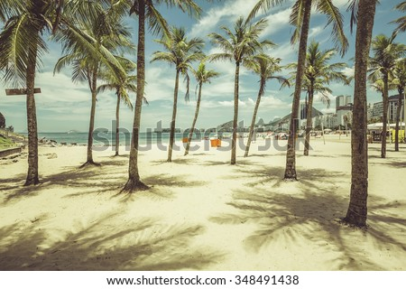 Palms with shadows on Copacabana Beach in Rio de Janeiro, Brazil. Vintage colors