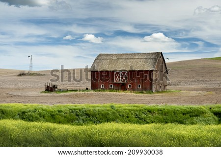"Palouse Barn. An old abandoned barn seen in the farming area of eastern Washington called the ""palouse"". Many such buildings can be seen in this rural landscape. - stock photo"