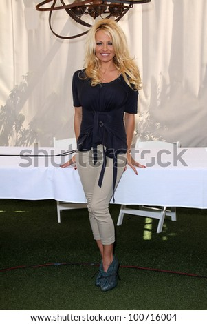 Pamela Anderson at a press conference for the New Online Social Platform FrogAds.com, Petit Ermitage, West Hollywood, CA 03-22-12 - stock photo
