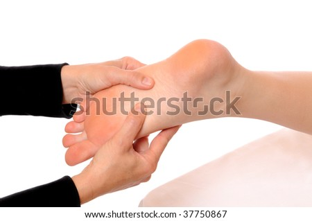 Pampering of the feet of a young woman - stock photo