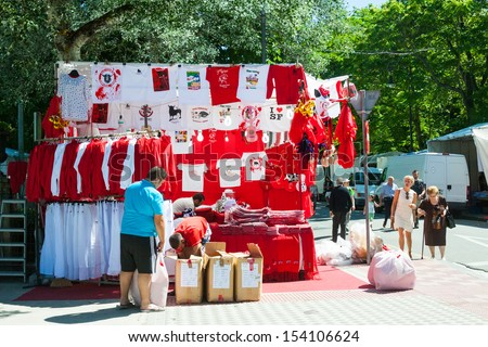 PAMPLONA, NAVARRE - JULY 5: Attributes of San Fermin festival in July 5, 2013 in Pamplona, Navarre. Clothing and souvenirs for San Fermin festival
