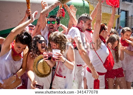 PAMPLONA, SPAIN -JULY 6, 2015: People are having fun at opening of San Fermin festival. Plaza Consistorial in front of municipality of Pamplona, Navarra. - stock photo