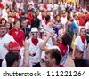 PAMPLONA, SPAIN -JULY 9: People are having fun at the opening of the San Fermin festival. Plaza in front of municipality. Pamplona, Navarra, Spain 9 July 2012 in Pamplona Spain. - stock photo