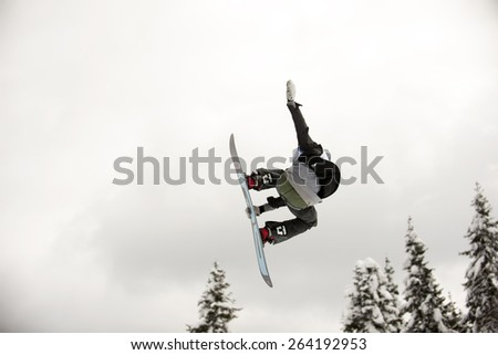 "PAMPOROVO,BULGARIA - MARCH 18 : Competitor performs trick during the ""Pamporovo Freestyle Open 14-19 March 2015"" in Pamporovo,Bulgaria on March 18, 2015"
