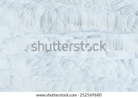 Pamukkale (cotton castle) natural wonder is created by a layers of white travertine looking like cotton, Turkey  - stock photo