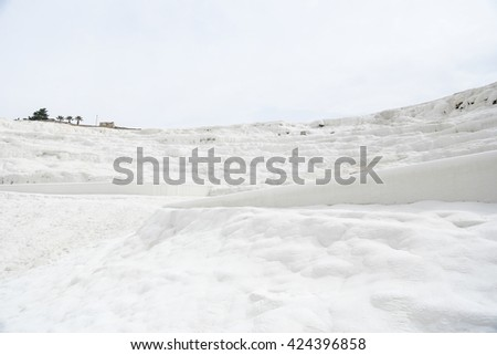Pamukkale Travertine pools and terraces. Pamukkale is famous UNESCO world heritage site in Turkey - stock photo