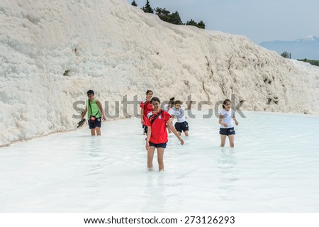 PAMUKKALE, TURKEY - APR 18, 2015: Unidentified tourists in a hot spring on the travertines of Pamukkale, Turkey. It's a UNESCO World Heritage site